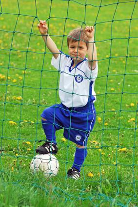 Junge im Fußballtor